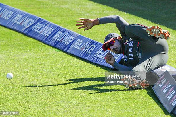 Amjad Ali of the United Arab Emirates fields the ball from the boundary during the 2015 ICC Cricket World Cup match between Zimbabwe and the United...