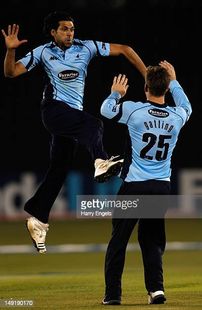 Amjad Khan of Sussex celebrates with teammate Joe Gatting after dismissing Hamish Marshall of Gloucestershire during the Friends Life T20 quarter...