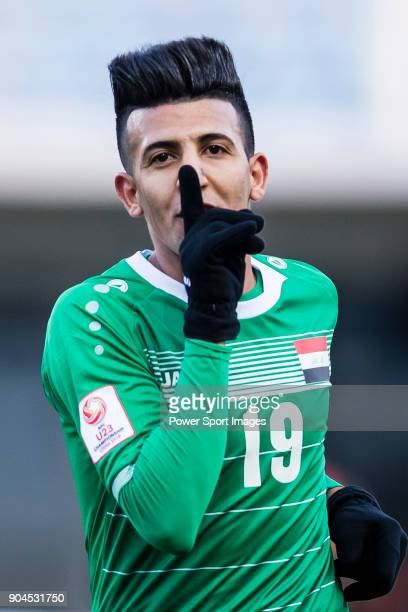 Amjed Attwan of Iraq celebrates after scoring his goal during the AFC U23 Championship China 2018 Group C match between Iraq and Malaysia at Changshu...