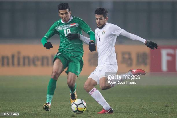 Amjed Attwan of Iraq fights for the ball with Saed Al Rosan of Jordan during the AFC U23 Championship China 2018 Group C match between Iraq and...