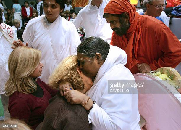 Amma the Hugging Saint whose real name is Mata Amritanandamyahi a guru from India gives a hug or Darshan as it is called to a follower 27 July 2007...