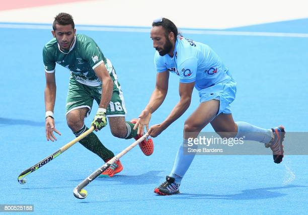 Ammad Shakeel of Pakistan and Sardar Singh of India battle for possession during the 5th8th place match between Pakistan and India on day eight of...