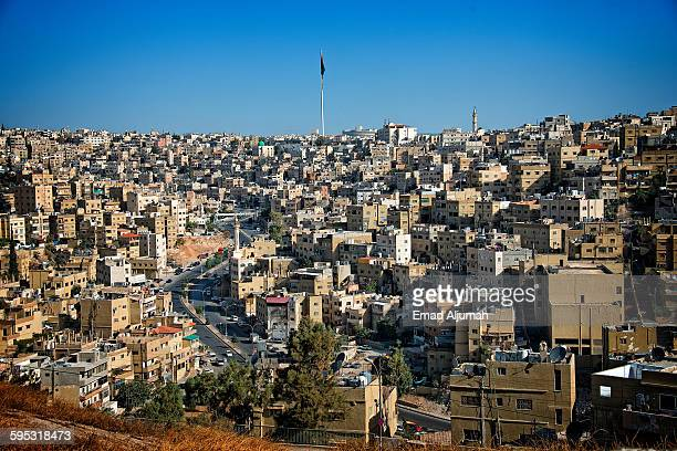 amman city view with big jordan flag and flagpole - flagpole sitting stock photos and pictures
