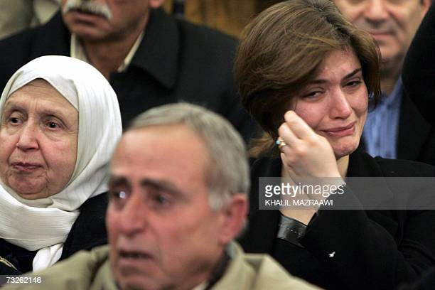 An unidentified woman cries as she joins some 3000 people taking part in a mourning rally held in the Jordanian capital Amman 08 February 2007 to...