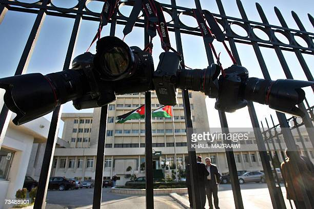 Cameras are hanged at the entrance of the Jordanian Parliament during a protest by Jordanian Journalists in Amman 04 March 2007 Jordan's parliament...