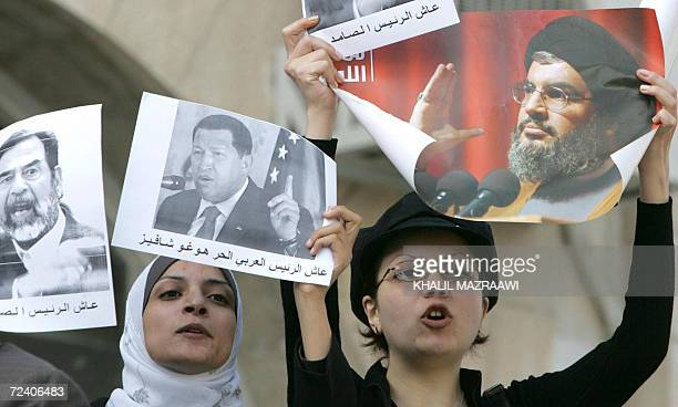 Jordanian demonstrators hold pictures of ousted Iraqi leader Saddam Hussein Venezuelan President Hugo Chavez and Lebanese Hezbollah leader Hassan...