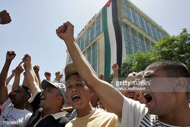 Jordanians protest in Amman 15 June 2006 against the visit made by four Jordanian Islamist MPs from the Islamic Action Front to the family of slain...
