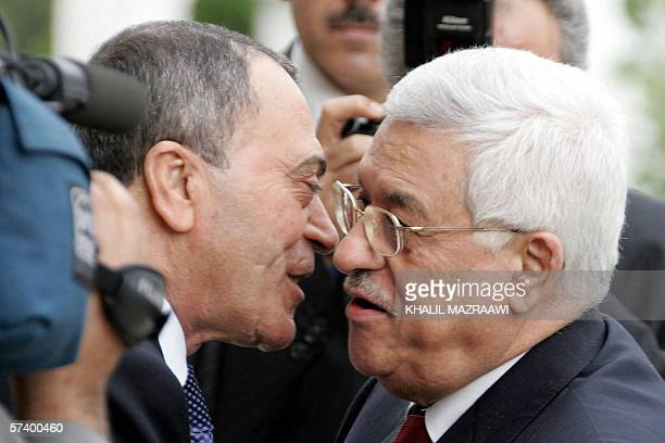 Palestinian Leader Mahmud Abbas is greeted by his Jordanian counterpart Maarouf Bakhit in Amman 22 April 2006 Abbas called dangerous and surprising...