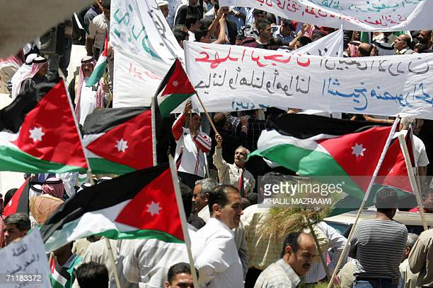 Some 2000 Jordanians along with tribal leaders stage a protest outside the parliament to denounce terrorismin 12 June 2006 in Amman Four detained...