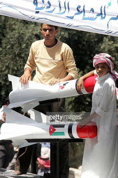 Two Jordanians stand by two rocket models during a protest in Amman 15 June 2006 against the visit made by four Jordanian Islamist MPs from the...