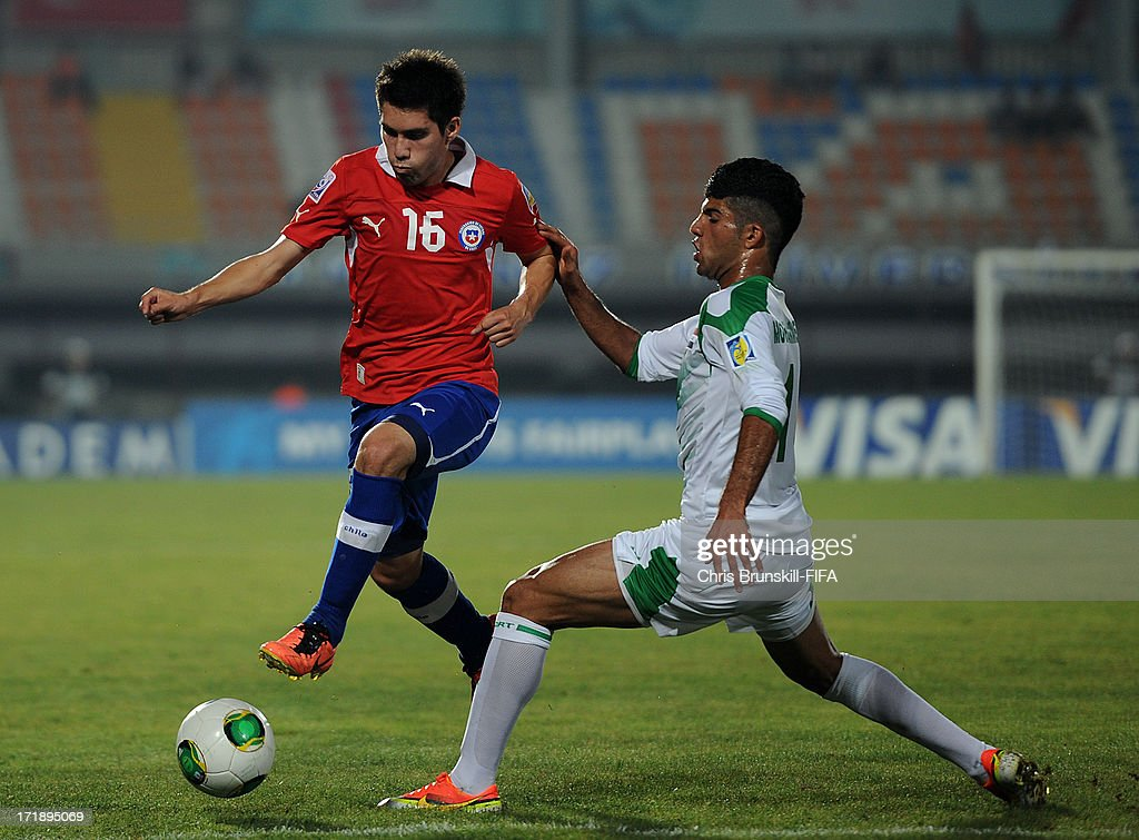 Ammar Abdulhussein (R) of Iraq challenges Cesar Fuentes of Chile during the FIFA U20 World Cup Group E match between Iraq and Chile at Akdeniz University Stadium on June 29, 2013 in Antalya, Turkey.