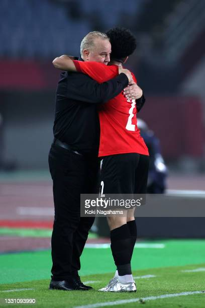 Ammar Hamdy of Team Egypt celebrates with Shawky Gharieb, Head Coach of Team Egypt after scoring their side's second goal during the Men's Group C...