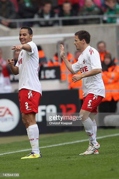 Ammer Jemal of Koeln celebrates the first goal with Sascha Riether during the Bundesliga match between 1. FC Koeln and SV Werder Bremen at...