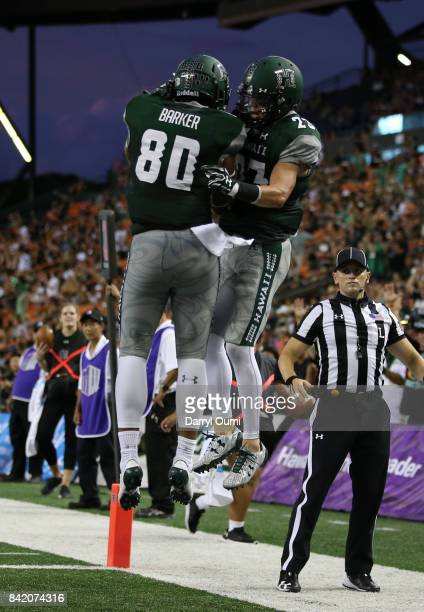 Ammon Barker and Dylan Collie of the Hawaii Rainbow Warriors celebrate after scoring a touchdown at Aloha Stadium on September 2 2017 in Honolulu...