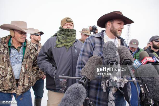 Ammon Bundy leader of a group of armed antigovernment protesters speaks to the media as other members look on at the Malheur National Wildlife Refuge...