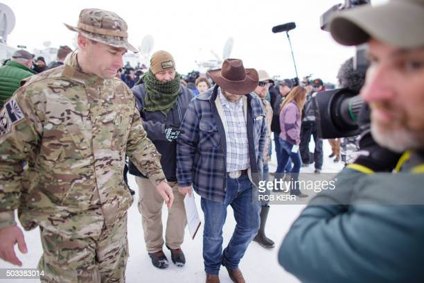 Ammon Bundy leader of a group of armed antigovernment protesters returns to the headquarters building after speakin to the media at the Malheur...