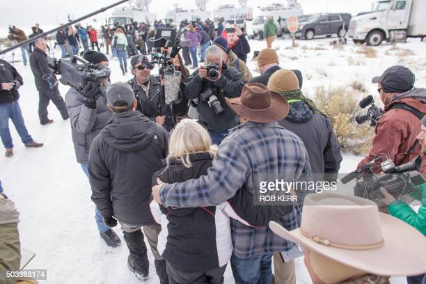 Ammon Bundy leader of a group of armed antigovernment protesters arrives to speak to the media as other members look on at the Malheur National...
