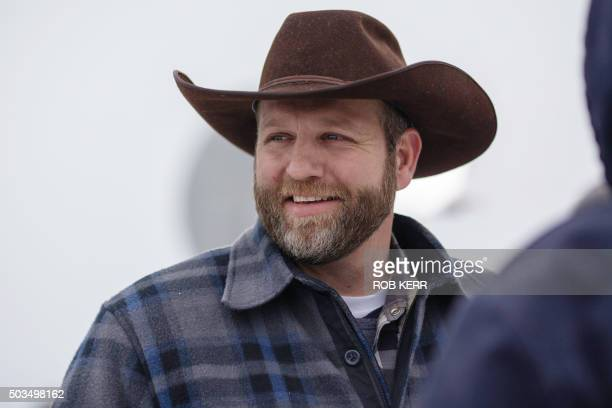 Ammon Bundy leader of an armed antigovernment militiareacts to a comment during a news conference at the entrance to the Malheur National Wildlife...