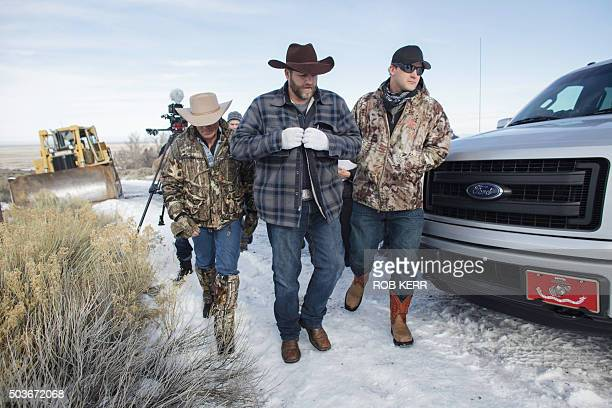 Ammon Bundy makes his way from the entrance of the Malheur National Wildlife Refuge Headquarters in Burns Oregon on January 6 2016 A small group of...