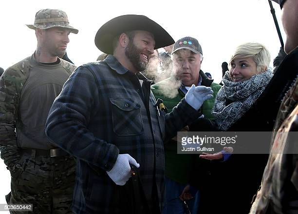 Ammon Bundy the leader of an antigovernment militia talks with Lindsay Rajt of PETA outside of the Malheur National Wildlife Refuge Headquarters on...