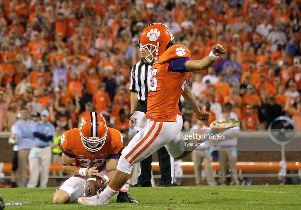 Ammon Lakip #36 of the Clemson Tigers kicks a field goal during the second quarter of the game against the North Carolina Tar Heels at Memorial Stadium on September 27, 2014 in Clemson, South Carolina.