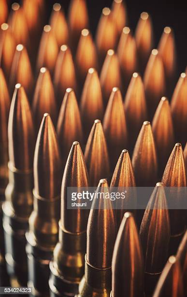 ammunition belt - gun control stock pictures, royalty-free photos & images
