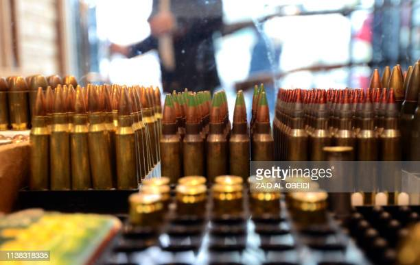 Ammunition is on display in a gun shop in the northern Iraqi city of Mosul on January 28 2019 Hunting rifles pistols and towers of ammunition...