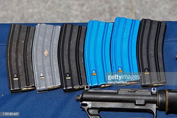 Ammunition magazines allegedly dropped by a gunman during a mass shooting spree at Santa Monica College are displayed at the Santa Monica Police...