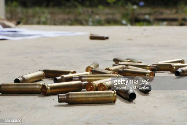 ammunition on ground - bullet stock pictures, royalty-free photos & images