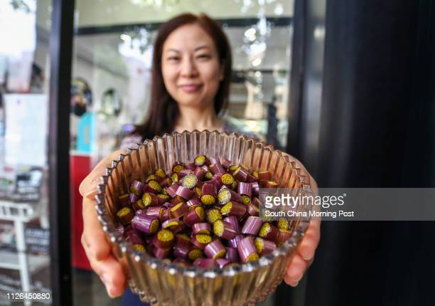 Ammy Ho Wingyan owner of candy shop Papabubble poses in front of her store in Tai Hang 19AUG14 [22AUG2014 BROADSHEET FOOD WINE]