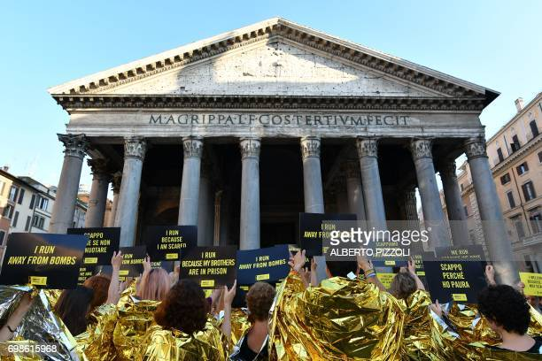 Amnesty International Activists gather in front of the Pantheon to stage a flashmob on World Refugee Day in central Rome on June 20 2017 Amnesty...
