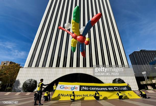 Amnesty International activists hold a giant dragonflyshaped balloon with a banner reading Google do not censor in China no to the Dragonfly project...
