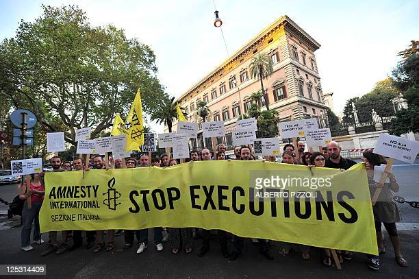 Amnesty International activists hold banners in support of Troy Davis in front of the US Embassy in Rome on September 16 during a protest to denounce...