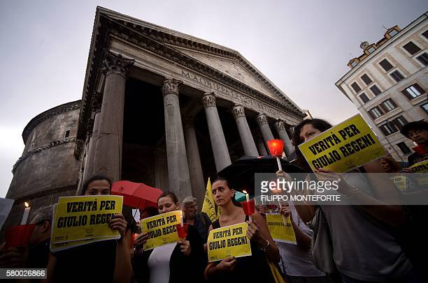 Amnesty International activists perform a candle light demonstration in Rome's Pantheon square on July 25 2016 to remember late Italian student...