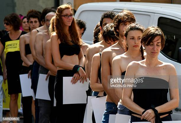 Amnesty International activists perform a flash mob on July 13 in Rome's Pantheon square to remember late Italian student Giulio Regeni and other...