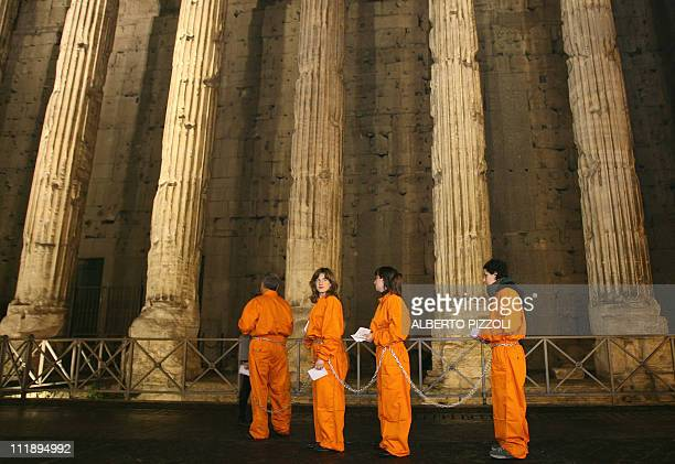 Amnesty International activists protest 11 January 2007 in Rome against the Guantanamo Bay detention camp The group's members and supporters were to...