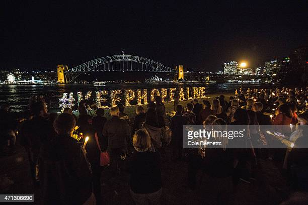 Amnesty international and Sydney Bali Nine activists hold a vigil in front of a flower wall that says '#keephopealive' in a last ditch effort to sway...