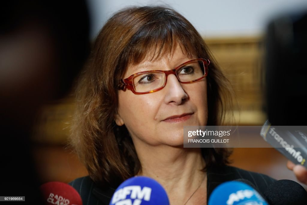 Amnesty International France's President Cecile Coudriou speaks to the press after a press conference for the release of the INGO annual report in Paris on February 21, 2018. /
