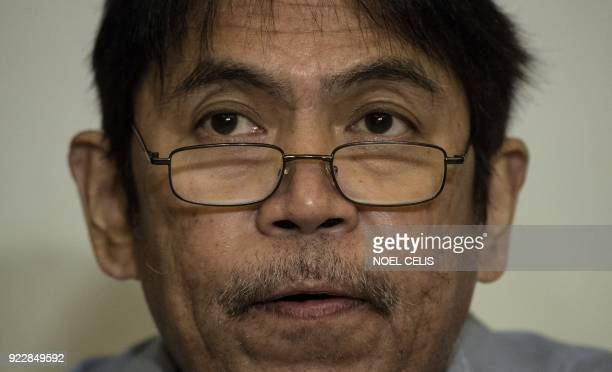 Amnesty International Philippines secretary director Jose Noel Olano reads a statement concerning their annual human rights report on the country...