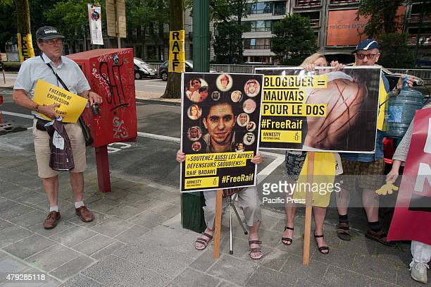 Amnesty International stage a protest in front of the Saudi embassy in Brussels against the flogging of Raif Badawi and to demand his freedom