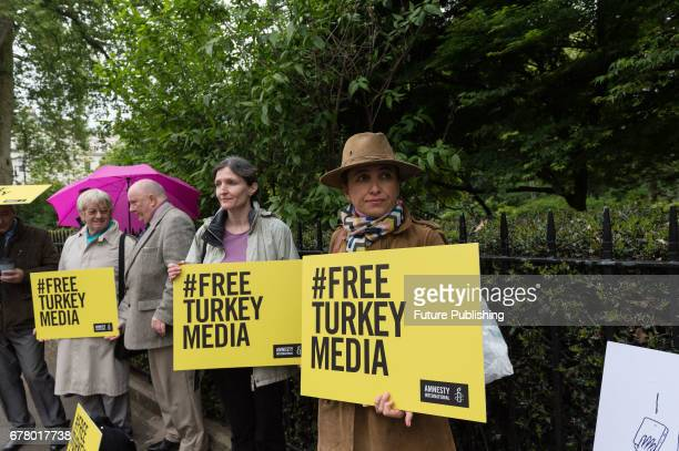 Amnesty International together with Procartoonist Pco and English PEN Writers at Risks organizations staged a vigil outside Turkish Embassy on May 03...