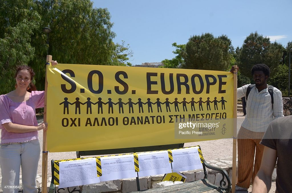Amnesty International volunteers hold a banner that carries