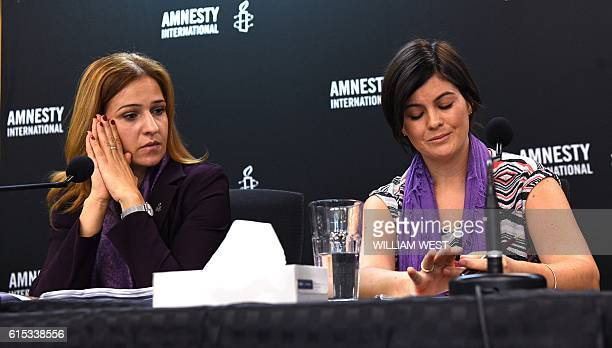 Amnesty International's senior director for research Anna Neistat speaks with former case manager on Nauru Sandra Bartlett during a press conference...