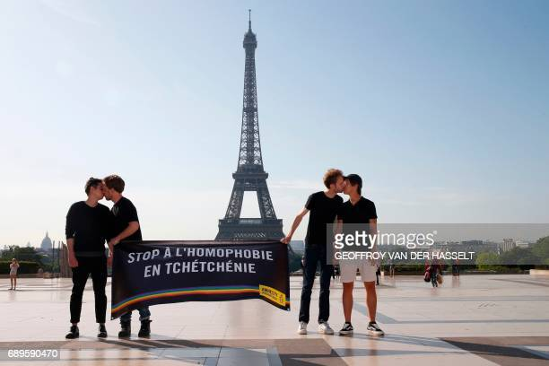 TOPSHOT Amnesty militants kiss each others as they hold a banner reading 'Stop homophobia in Chechnya' to denounce persecution against LGBT community...