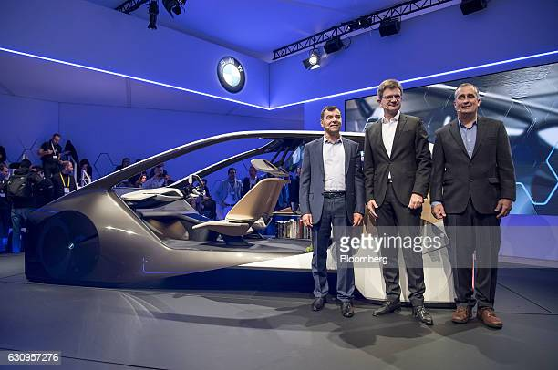 Amnon Shahua chairman and chief technology officer of Mobileye from left Klaus Froehlich member of the management board at Bayerische Motoren Werke...