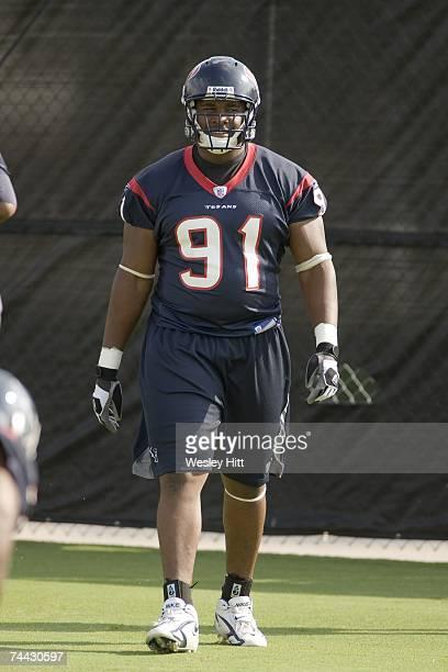 Amobi Okoye of the Houston Texans warms up during OTA camp at the Texans Methodist Training Center on June 7, 2007 in Houston, Texas.