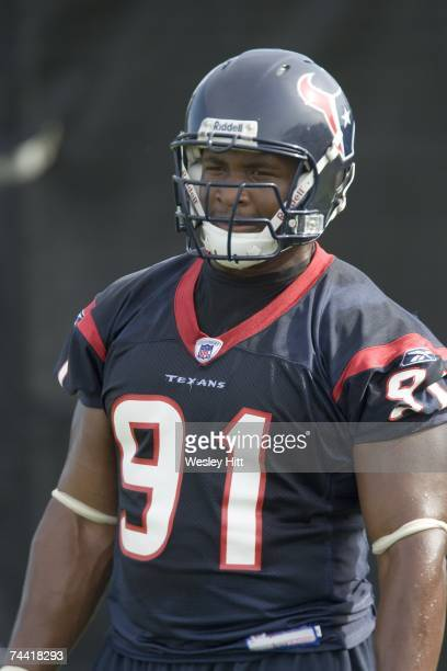 Amobi Okoye of the Houston Texans watches a play during OTA camp at the Texans Methodist Training Center on June 6, 2007 in Houston, Texas.