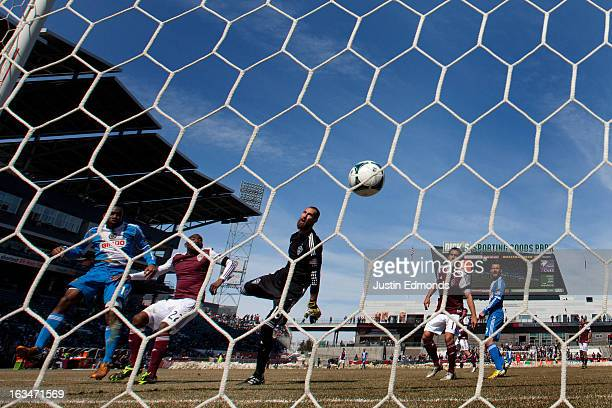 Amobi Okugo of the Philadelphia Union heads the ball in for a goal past Marvell Wynne and goalkeeper Matt Pickens of the Colorado Rapids during the...