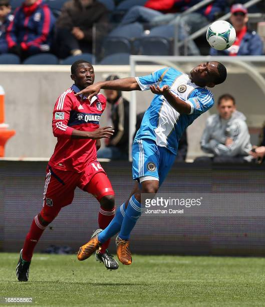 Amobi Okugo of the Philadelphia Union heads the ball in front of Patrick Nyarko of the Chicago Fire during an MLS match at Toyota Park on May 11 2013...
