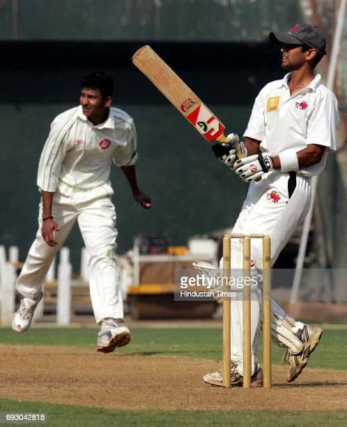 Amol Mujumdar of Mumbai hooks Sanjay Bangar for six in the Elite Division Ranji Match against Railways at Wankhede